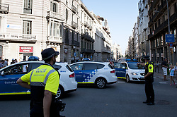 BARCELONA (SPAIN), Aug. 17, 2017  Police cordon off a nearby street following a terrorist attack in central Barcelona, Spain, on Aug. 17, 2017. Thirteen people were killed, 80 others injured and hospitalized with 15 of them in serious condition in Barcelona terrorist attack on Thursday afternoon, Spanish official said. (Credit Image: © Lino De Vallier/Xinhua via ZUMA Wire)