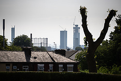 "© Licensed to London News Pictures . 26/07/2018. Manchester , UK . Manchester Cityscape including Beetham Tower and the ""Twin Towers"" development (currently under construction) , as viewed from Salford . Photo credit : Joel Goodman/LNP"