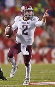 Texas A&M quarterback Johnny Manziel points as he looks to make a pass during an NCAA college football game against the Arkansas Razorbacks in Fayetteville, Ark., Saturday, Sept. 28, 2013. Texas A&M defeated Arkansas 45-33. (AP Photo/Beth Hall)