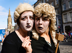 Edinburgh, Scotland, UK. 2 August 2019. On the opening day of the Edinburgh Festival Fringe these two young women were handing out flyers to the contemporary theatre production Limbo by Meeting Place Theatre.