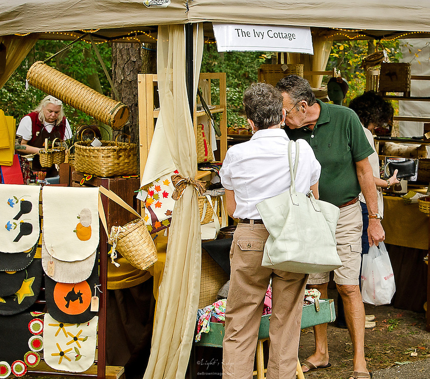 People browse at The Ivy Cottage vendor during the 2012 Wheaton Arts Fine Craft Festival.
