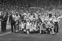 File photo dated 16-05-1987 of Coventry City celebrate with the FA Cup after winning 3-2 after extra time. (l-r top) George Curtis (managing director), John Sillett (chief coach), Cyrille Regis, Keith Houchen, Lloyd McGrath, Trevor Peake, Brian Kilcline, Steve Sedgley, Dave Bennett and Jake Findlay. (front l-r) Micky Gynn, Dave Phillips, Steve Ogrizovic, Nick Pickering, Graham Rodger and Gregg Downs.