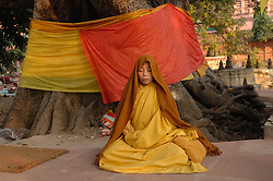 Bodh Gaya or Bodhgaya is a city in Gaya district in the Indian state of Bihar. It is famous for being the place of Buddha's attainment of Enlightenment. Thousands of Buddhists from all over the world gather in front of the tree where he attained enlightment in December 2006. For Buddhists, Bodh Gaya is the most important of the main four pilgrimage sites related to the life of Gautama Buddha. Since 1953, Bodh Gaya has been developed as an international place of pilgrimage. Buddhists from Sri Lanka, Thailand, Burma, Tibet, Bhutan and Japan have established monasteries and temples within easy walking distance of the Mahabodhi compound.