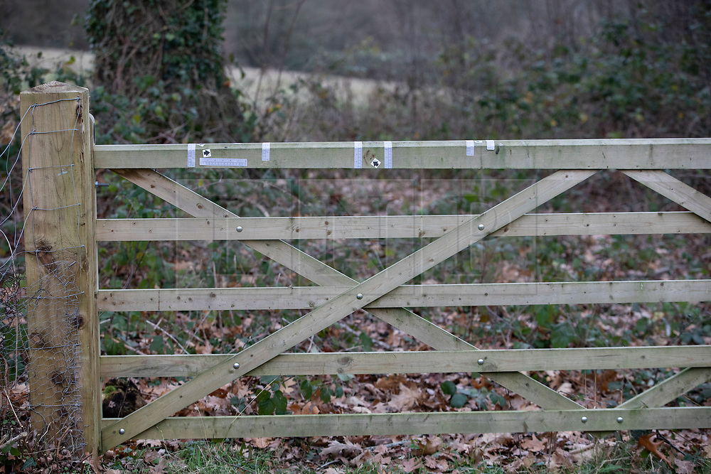 © Licensed to London News Pictures. 05/01/2019. Clandon, UK. Police evidence markers are seen on a gate near West Clandon station in Surrey - where a man left the Waterloo bound train after a passenger was stabbed to death yesterday. A murder investigation has been launched after the man was attacked while on board the 12. 58pm train service travelling between Guildford and London Waterloo. A man and a woman have been detained by police in Farnham in connection with the murder. Photo credit: Peter Macdiarmid/LNP