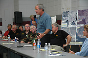 President Bush speaks to a room full of county and elected officials and is joined by Governor of Mississippi Haley Barbour,seated behind president,  for a meeting with elected officials from all the affected counties from Hurricane Katrina in Poplarville Ms.Monday Sept. 5,2005. Bush said he has Mississippi on his mind and that the goverment is here to help. Hurricane Katrina is the worst natural disaster to hit American soil and the National and local goverments are working together to clean up the mess from the catasrophic destruction. (Photo/Suzi Altman)