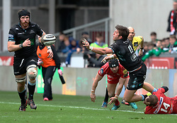 Glasgow Warriors' DTH Van Der Merwe offloads in the tackle<br /> <br /> Photographer Simon King/Replay Images<br /> <br /> Guinness PRO14 Round 19 - Scarlets v Glasgow Warriors - Saturday 7th April 2018 - Parc Y Scarlets - Llanelli<br /> <br /> World Copyright © Replay Images . All rights reserved. info@replayimages.co.uk - http://replayimages.co.uk