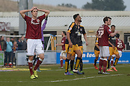 Northampton Town Defender Luke Prosser holds his head in his hands after Cobblers hit the post in injury time  during the Sky Bet League 2 match between Northampton Town and Cambridge United at Sixfields Stadium, Northampton, England on 12 March 2016. Photo by Dennis Goodwin.