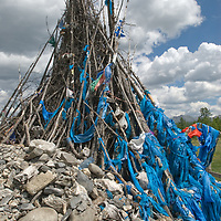 """MONGOLIA. Darhad Valley. """"Ovo"""" shrine atop a small pass, where travelers leave talismans, such as skulls of prized horses or religious artifacts. These reflect spiritual traditions of Tibetan Buddhism, animism and shamanism."""