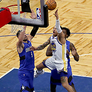 ORLANDO, FL - FEBRUARY 19:  Juan Toscano-Anderson #95 of the Golden State Warriors drives to the net past Nikola Vucevic #9 and Al-Farouq Aminu #2 of the Orlando Magic during the second half at Amway Center on February 19, 2021 in Orlando, Florida. NOTE TO USER: User expressly acknowledges and agrees that, by downloading and or using this photograph, User is consenting to the terms and conditions of the Getty Images License Agreement. (Photo by Alex Menendez/Getty Images)*** Local Caption *** Juan Toscano-Anderson; Nikola Vucevic; Al-Farouq Aminu