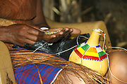 Gourds decorated with beads. The dry gourd is used for storing liquids. Photographed in a Datooga village, Tanzania