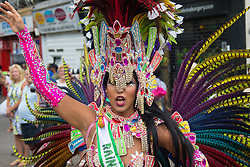 London, August 29th 2016. Colour, feathers and dancing on Ladbroke Grove during day two of Europe's biggest street party, the Notting Hill Carnival.