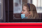 A passenger wearing face protective surgical masks travel by Red Bus along Strand in Central London on Friday, July 24, 2020, as the new rules on wearing masks in England have come into force, with people going to shops, banks and supermarkets now required to wear face coverings. <br /> Authorities said that Police can hand out fines of 100 pounds if people refuse, but authorities are hoping that peer pressure will prompt compliance. (VXP Photo/ Vudi Xhymshiti)