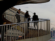 people descending and ascending a circular stair