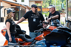 Elizabeth Thurman, an engineer at Harley-Davidson and Harley-Davidson's Demo Coordinator Walt Nunley and Police Fleet Representative Jeffery Dickey (r) worked the Harley-Davidson test ride Pop-Up in Deadwood, which  was a popular new addition in 2019 where riders took a Harley out for a full hour on the beautiful Black Hills twisty's during the Sturgis Black Hills Motorcycle Rally. SD, USA. Friday, August 9, 2019. Photography ©2019 Michael Lichter.