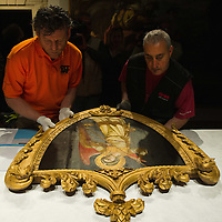 PADOVA, ITALY - APRIL 13:  Two technicians move one of the Angels paintings by Guariento coming from a private collection which will be on display on April 13, 2011 in Padova, Italy. The Guariento exhibition will be open from April 16th until July 31st in the renovated Foundation Cariparo in Piazza del Duomo.