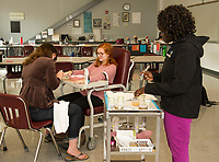 Erika Mosher, Madi Smith and Haylee Perry set up nurse/patient scenarios during Gina McGuire's Nurse Assisting program at the Huot Technical Center on Thursday morning.  (Karen Bobotas/for the Laconia Daily Sun)