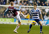 Photo: Gareth Davies.<br />Reading v West Ham United. The Barclays Premiership. 01/01/2007.<br />West Ham's Paul Konchesky (L) goes in for the ball from Reading's John Oster (R).