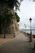 People enjoying and evening stroll along the walkway around La Foraleza in San Juan Puerto Rico