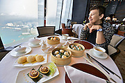 China, Hong Kong S.A.R..The Ritz-Carlton, Hong Kong. World's highest Dim Sum at Tin Lung Heen..From l.:.Baked barbequed pork buns with almond crust. Baked abalone and roasted goose puff. Pork and shrimp dumplings with matsutake mushroom. Golden shrimp dumplings with bamboo shoots and asparagus. Shrimp and vegetable dumplings with spicy cod roe.
