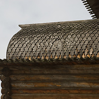 The shingled roof of relocated historic Russian Orthodox church is preseved in the Malye Korely outdoor museum, in taiga forests near the northern port of Arkhangel'sk, at the edge of the White Sea and Arctic Ocean.