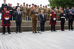 London, June 23rd 2014. London mayor Boris Johnson, second left, joins members and veterans of the armed forces as they gather at City Hall for a flag raising ceremony to mark Armed Forces Day.