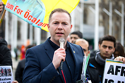 © Licensed to London News Pictures. 14/03/2018. London, UK. A Sinn Fein spokesman speaks in solidarity with Pro-Kurdish demonstrators protesting against Turkish oppression of Kurds and the bombing of Afrin, Northern Syria. The road was blocked for approximately two hours by demonstrators. Photo credit : Tom Nicholson/LNP