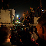 December 11, 2012 - Cairo, Egypt: Protestors bring down a concrete wall set up outside the presidential place in Cairo, where tens of thousands gathered to voice their anger at the planned constitution, which will be put to a referendum next Saturday...The Egyptian army has reportedly called talks between President Mohamed Morsi and the opposition to end violent protests against a draft constitution...Sporadic clashes between supporters and opponents of president Mohamed Morsi, erupted in the past week over his assumption of extraordinary powers and the scheduling of the referendum. (Paulo Nunes dos Santos/Polaris)