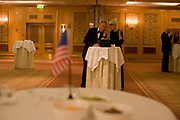 Elderly members of expatriate US citizens and 'Democrats Abroad' party supporters talk in an empty ballroom before others arrive to celebrate the inauguration of Barack Obama as the United States' 44th President, after his Nov 08 election victory as America's first African American Commander in Chief. The location is The Royal Lancaster Hotel in central London, England. Similar events were held by Democrats Abroad around the world but in England, Obama's election to the White House excited Britain's political and cultural landscape during a deep economic recession.