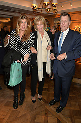Left to right, KATIE ELLIOT and her parents SIMON & ANNABEL ELLIOT at a party to celebrate the publication of 'Let's Eat meat' by Tom Parker Bowles held at Fortnum & Mason, Piccadilly, London on 21st October 2014.