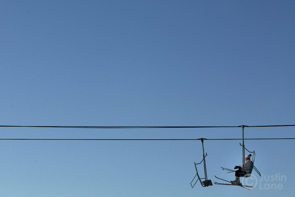 A skier is seen on the chair lift at the Suicide Six ski area in Woodstock, VT.<br /> JUSTIN LANE FOR THE NEW YORK TIMES