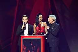 EDITORIAL USE ONLY.<br /><br />Jennifer Hudson, Sir Tom Jones and Olly Murs on stage at the Brit Awards at the O2 Arena, London.