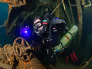 KISS rebreather scuba diver inside the engine room of the Aeolus shipwreck, in North Carolina, USA
