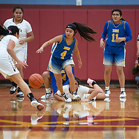 Zuni's Kaitlin Romancito (4) and Rehoboth Christian's Patricia Chavira (22) try to gain control of a loose ball  Friday night at Rehoboth Christian School in Rehoboth.