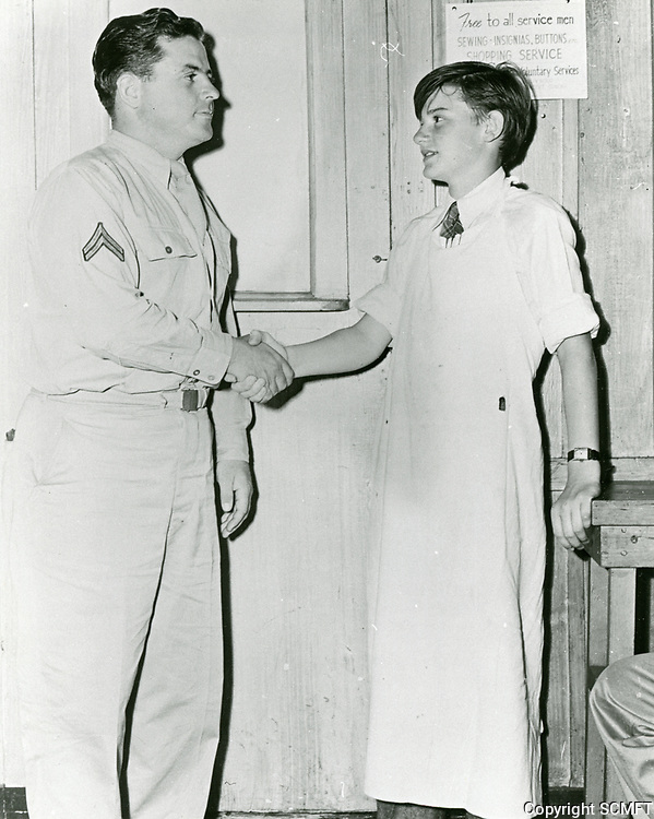 1943 Child actor, Roddy McDowell shakes hands with a visiting serviceman at the Hollywood Canteen