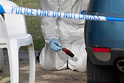 © Licensed to London News Pictures. 21/05/2020. Beaconsfield, UK. A forensic investigator recovers a screwdriver type tool from underneath a vehicle parked inside a cordon at a property on North Drive in Beaconsfield. Thames Valley Police were called to North Drive, Beaconsfield at around 00:01 BST on Thursday 21/05/2020 to a report of a stabbing. A man in his forties had sustained injuries consistent with stab wounds and was taken to hospital. Photo credit: Peter Manning/LNP