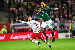 November 13, 2017 - Gdansk, Poland - Karol Linetty (POL) vies Jonathan dos Santos (MEX) during the International Friendly match between Poland and Mexico at Energa Stadium in Gdansk, Poland on November 13, 2017. (Credit Image: © Foto Olimpik/NurPhoto via ZUMA Press)