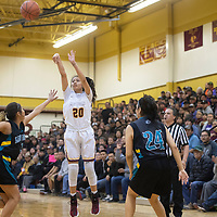 Tohatchi Cougar Cameron Tsosie (20) takes a jump shot against Navajo Prep at Tohatchi High School Thursday night in Tohatchi.
