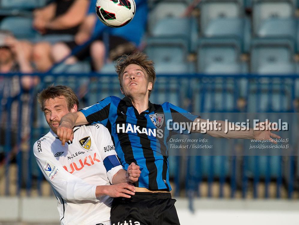 Ville Nikkari, vas. Jussi Vasara. Inter - Honka. Veikkausliiga.2.6.2013. Photo: Jussi Eskola