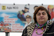 Atyrau, Kazakhstan, 16/11/2003..Environmental activist Galina Chernova who has campaigned against foreign oil companies, with roadside billboard promoting the activities of Italian company Agip.