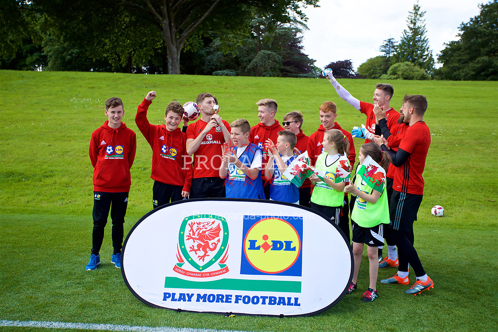 CARDIFF, WALES - Wednesday, June 7, 2017: Wales Ben Davies receives a trophy during a Lidl Play More Football filming session at the Vale Resort ahead of the 2018 FIFA World Cup Qualifying Group D match against Serbia. (Pic by David Rawcliffe/Propaganda)