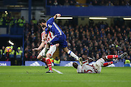 Diego Costa of Chelsea shoots and scores his sides 4th goal. Premier league match, Chelsea v Stoke city at Stamford Bridge in London on Saturday 31st December 2016.<br /> pic by John Patrick Fletcher, Andrew Orchard sports photography.
