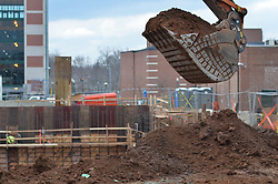 Shovel end of a Hitachi Excavator dropping soil in earthmoving operations. Central Connecticut State University. New Academic / Office Building.  Project No: BI-RC-324. Architect: Burt Hill Kosar Rittelmann Associates. Contractor: Gilbane Building Company, Glastonbury, CT.