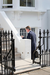 © Licensed to London News Pictures. 13/09/2016. London, UK. Former Prime Minister David Cameron walks down to the basement as he arrives at a new London address on the day after he resigned as an Member of Parliament. Photo credit: Peter Macdiarmid/LNP