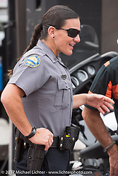 Daytona Police Motorcycle Officer Deschamps at the Harley-Davidson Speedway display during Daytona Bike Week. Daytona Beach, FL. USA. Monday March 13, 2017. Photography ©2017 Michael Lichter.