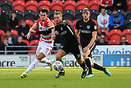Doncaster Rovers forward John Marquis (9) and Portsmouth FC midfielder Tom Naylor (7) during the EFL Sky Bet League 1 match between Doncaster Rovers and Portsmouth at the Keepmoat Stadium, Doncaster, England on 25 August 2018.Photo by Ian Lyall.
