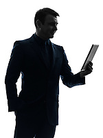 one  business man holding digital tablet smiling in silhouette on white background