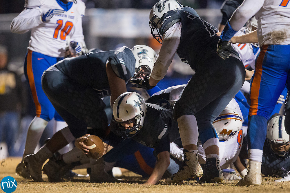Hickory Ridge Ragin' Bulls quarterback Trevor Shue (15) extends the football over the goal line for the game winning touchdown against the Marvin Ridge Mavericks in the third round of the NCHSAA 3A playoffs at Hickory Ridge High School on December 2, 2016 in Harrisburg, North Carolina.  The Ragin' Bulls defeated the Mavericks 55-49 in 4 overtimes.  (Brian Westerholt/Special to the Independent Tribune)