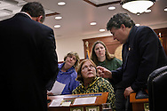 Democratic Alaskan state representatives discuss potential problems with a bill revising drivers' licenses and identification rules for teenagers. From left to right, House Minority Leader Beth Kerrula, rep. Berta Gardner, rep. Lindsey HOlmes, rep. Harry Crawford, Jr.
