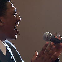 (COMMUNITY) Manalapan 3/27/2004  John Moses Cross a vocalist from Neptune sings a song during the 13th annual Afternoon of Arts and Music sponsored by the Central Jersey Branch of the National Association of Negro Business and Porfessional Women's Club.   Michael J. Treola Staff Photographer...MJT