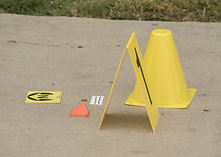 August 15, 2017 - Fullerton, CA, USA - A drop of blood is marked as evidence on the sidewalk at a murder investigation where a man in his 30s stabbed his mother and her boyfriend in Fullerton, CA on Tuesday, August 15, 2017. (Credit Image: © Ken Steinhardt/The Orange County Register via ZUMA Wire)
